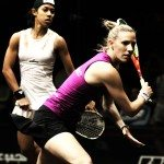 An image of two women playing squash together.